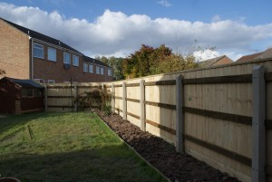 1.8m high closeboard on concrete posts with capping