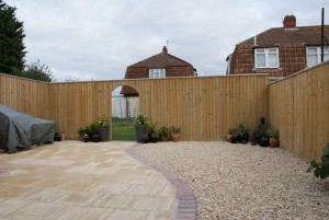 Gar1.8m and 2.1m high closeboard with archwayden fence panels
