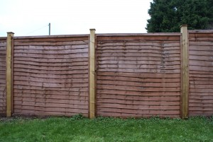 """1.8m high Windcheater panels with 4x4"""" wooden posts"""